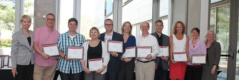 Academic Innovation Fund Leaders holding plaques