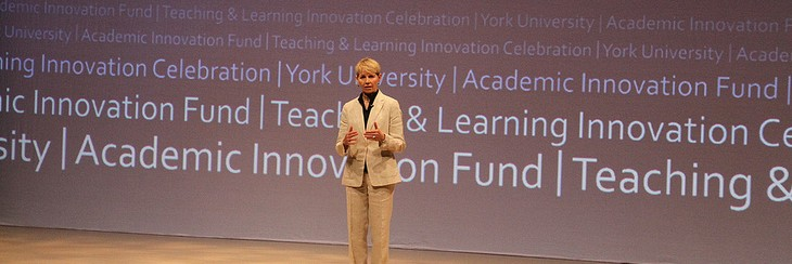 Sue Vail presenting on stage